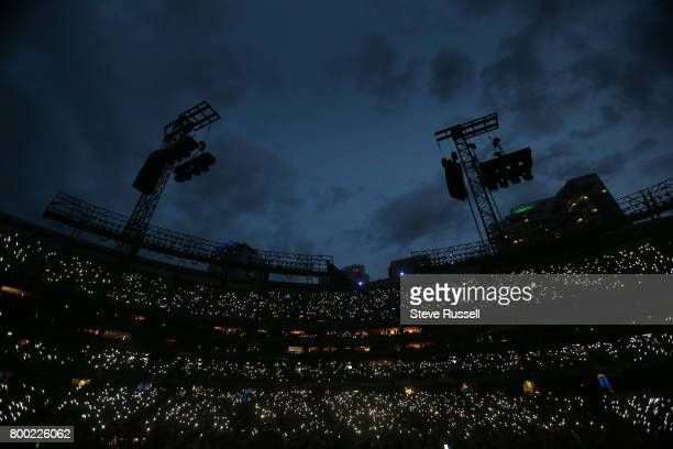TORONTO ON JUNE 23 Cell phone lights illuminate the crowd under a open sky as U2 plays 'Where the Streets have no name' at the Rogers Centre on their...