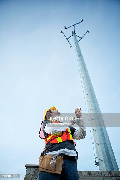 cell phone tower technician with tablet computer - communication occupation stock pictures, royalty-free photos & images