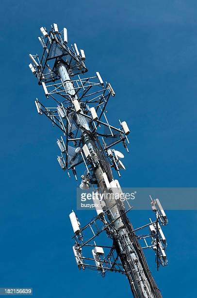 A cell phone tower with blue sky