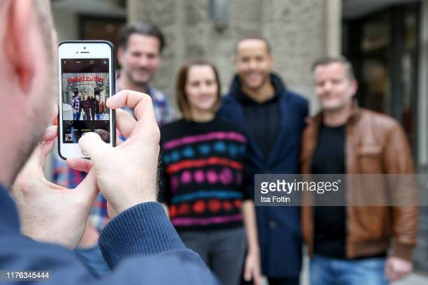 Cell phone view of German actor Simon Boeer German presenter Bella Lesnik TV Bachelor Andrej Mangold and German actor Andre Dietz during the...
