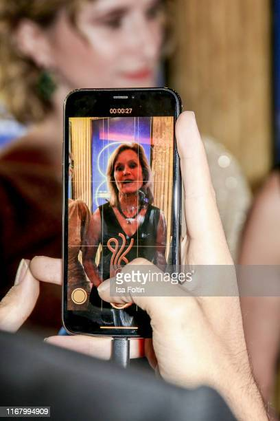 Cell phone view of German politician and award winner Helga Truepel at the award ceremony of the Deutscher Schauspielpreis at Zoo Palast on September...