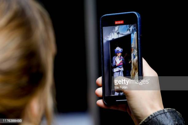 Cell phone view of German presenter Bella Lesnik during the Globetrotter celebrates 40th Anniversary event on October 17 2019 in Cologne Germany