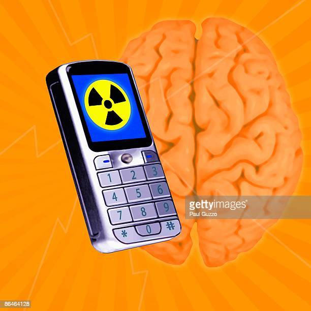 Cell phone with radiation symbol and brain