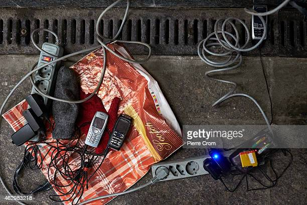 Cell phones and batteries recharge in a tunnel under the railway station due to a power outage in the area on February 8, 2015 in Donetsk, Ukraine....