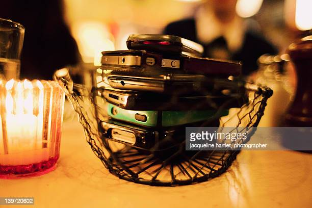 cell phones on dinner table - harriet stock photos and pictures