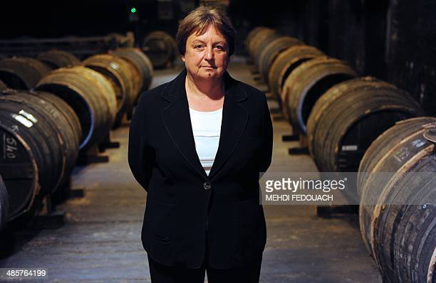 Cellar master of the Remy Martin cognac house Pierrette Trichet poses in a wine cellar in Cognac western France on April 10 2014 First and only woman...