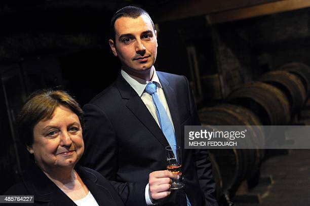 Cellar master of the Remy Martin cognac house Pierrette Trichet poses with her successor Baptiste Loiseau in a wine cellar in Cognac western France...