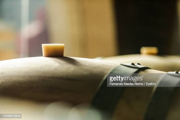 cellar with wooden barrels to store wine, beer, rum, whiskey - whisky stock pictures, royalty-free photos & images