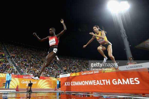Celliphine Chepteek Chespol of Kenya and Aisha Praught of Jamaica clear the water jump competes in the Women's 3000 metres Steeplechase final during...