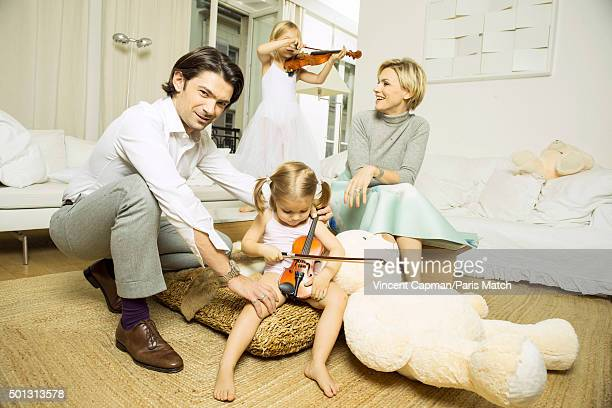 Cellist Gautier Capucon with his wife Delphine and their daughters Fee and Sissi are photographed for Paris Match on November 29 2015 in Paris France