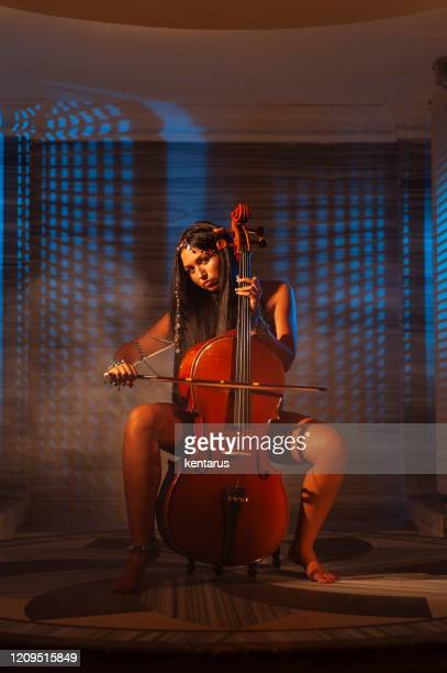 cellist musician woman performing in turkish bath - cellist stock pictures, royalty-free photos & images