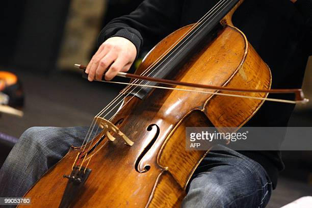 """Cellist plays during a rehearsal of the show """"Jack the ripper"""" with British jazz saxophonist and composer Andy Sheppard, on May 12 during the jazz..."""