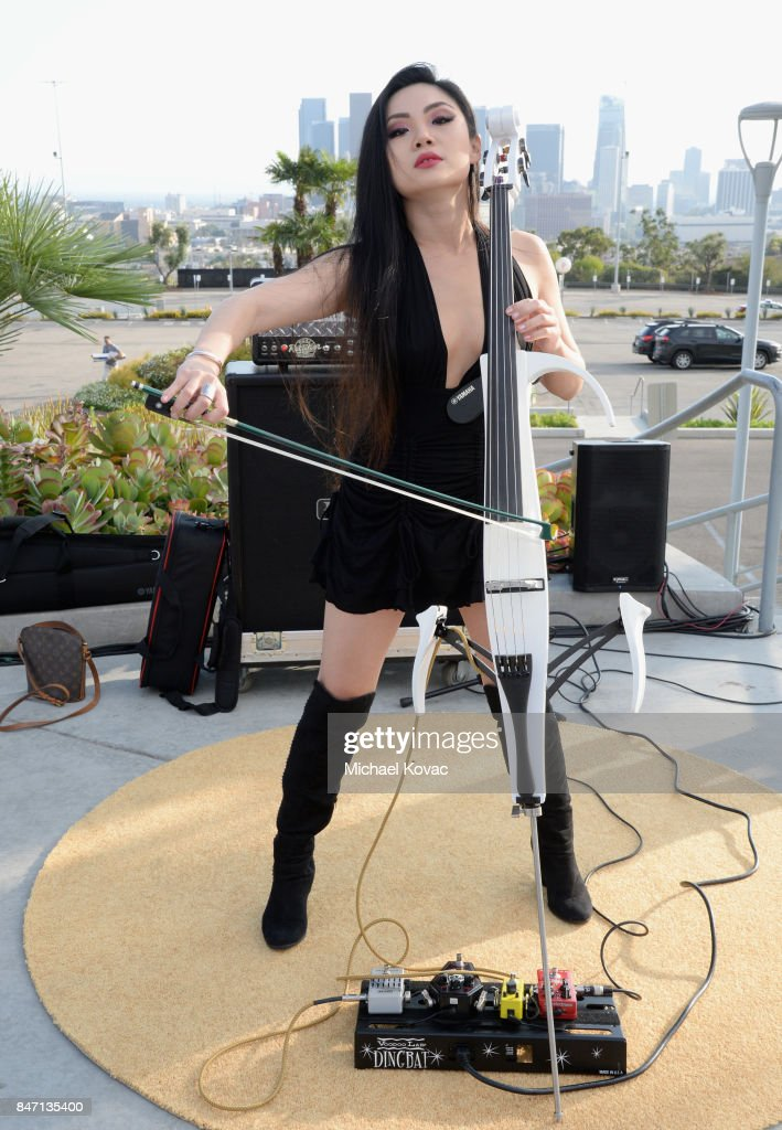 Cellist Tina Guo performs during the Warner Bros. Home Entertainment and Intel presentation of 'Wonder Woman in the Sky' at Dodger Stadium on September 14, 2017 in Los Angeles, California.