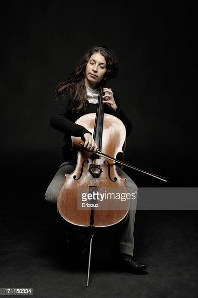 cellist with closed eyes - cellist stock pictures, royalty-free photos & images