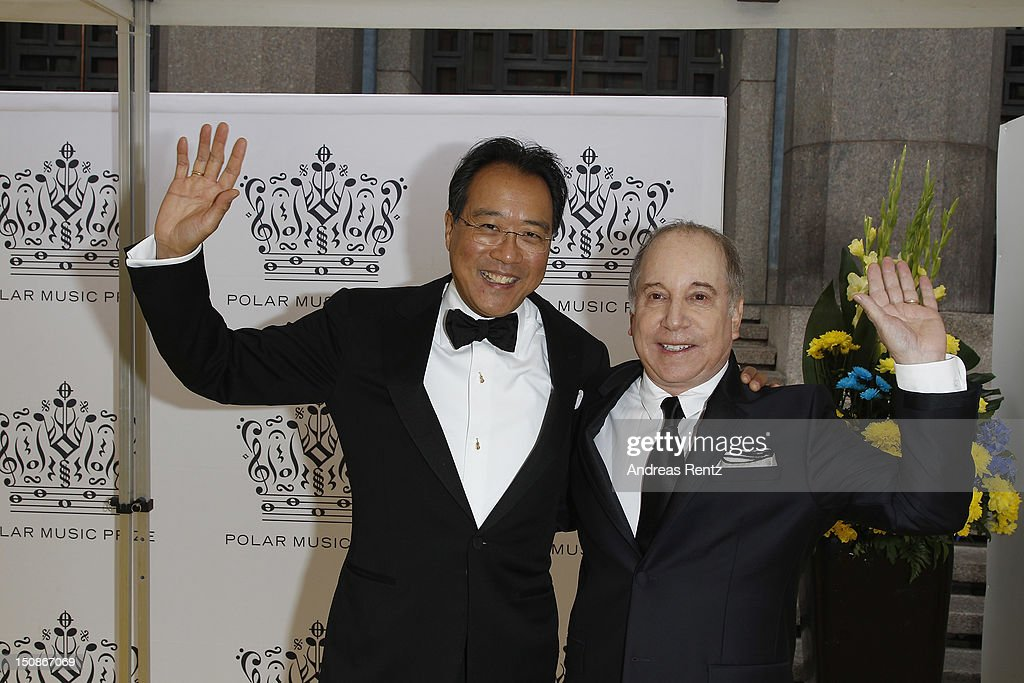 Cellist Yo-Yo Ma and artist Paul Simon arrive for the Polar Music Prize at Konserthuset on August 28, 2012 in Stockholm, Sweden.