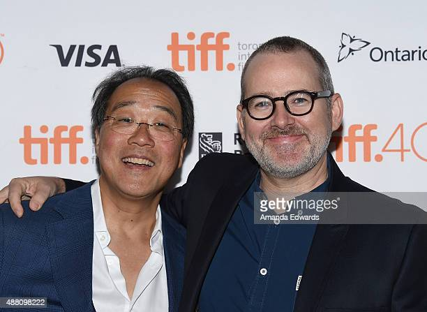 Cellist YoYo Ma and director Morgan Neville attend The Music of Strangers YoYo Ma and the Silk Road Ensemble photo call during the 2015 Toronto...