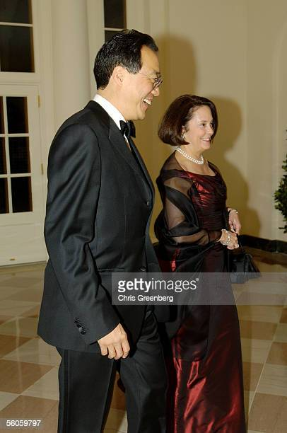 Cellist YoYo Ma and Jill Hornor react to a reporter's question as they walk through the Booksellers room of the White House en route to a social...