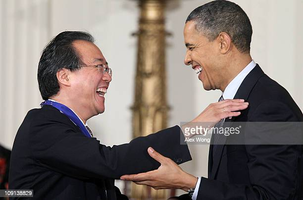 Cellist YoYo Ma laughs with US President Barack Obama after he was presented with the 2010 Medal of Freedom during an East Room event at the White...