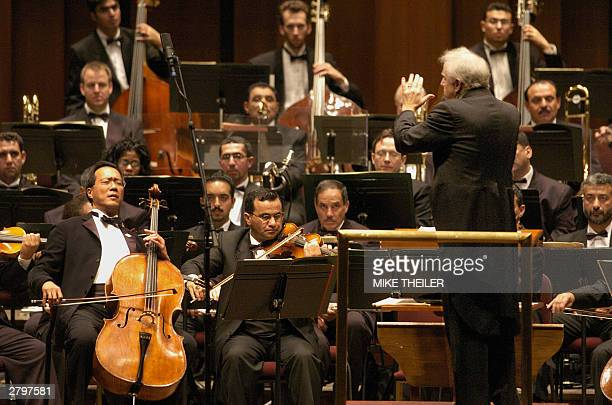 Cellist YoYo Ma plays as Conductor Leonard Slatkin conducts during a performance by a combined National Symphony Orchestra and the Iraqi National...