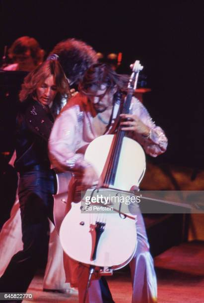 Cellists Melvyn Gale and Hugh McDowell of Electric Light Orchestra perform live at the Oakland Coliseum in Oakland, California on August 23, 1978