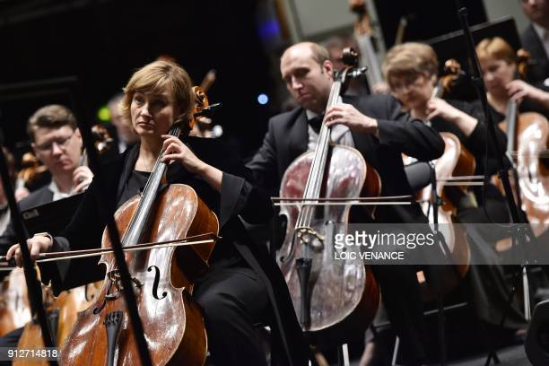 Cellists of the Ural Philharmonic Orchestra rehearse a musical piece composed by Russian composer Sergei Rachmaninoff and leaded by Russian director...