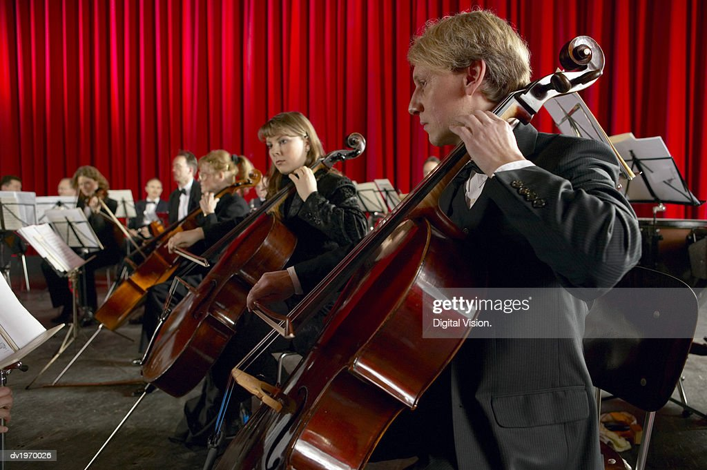 Cellists Performing in an Orchestra : Stock Photo