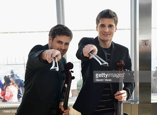 Cellists Stjepan Hauser and Luka Sulic of 2CELLOS visit The Empire State Building on January 22 2013 in New York City