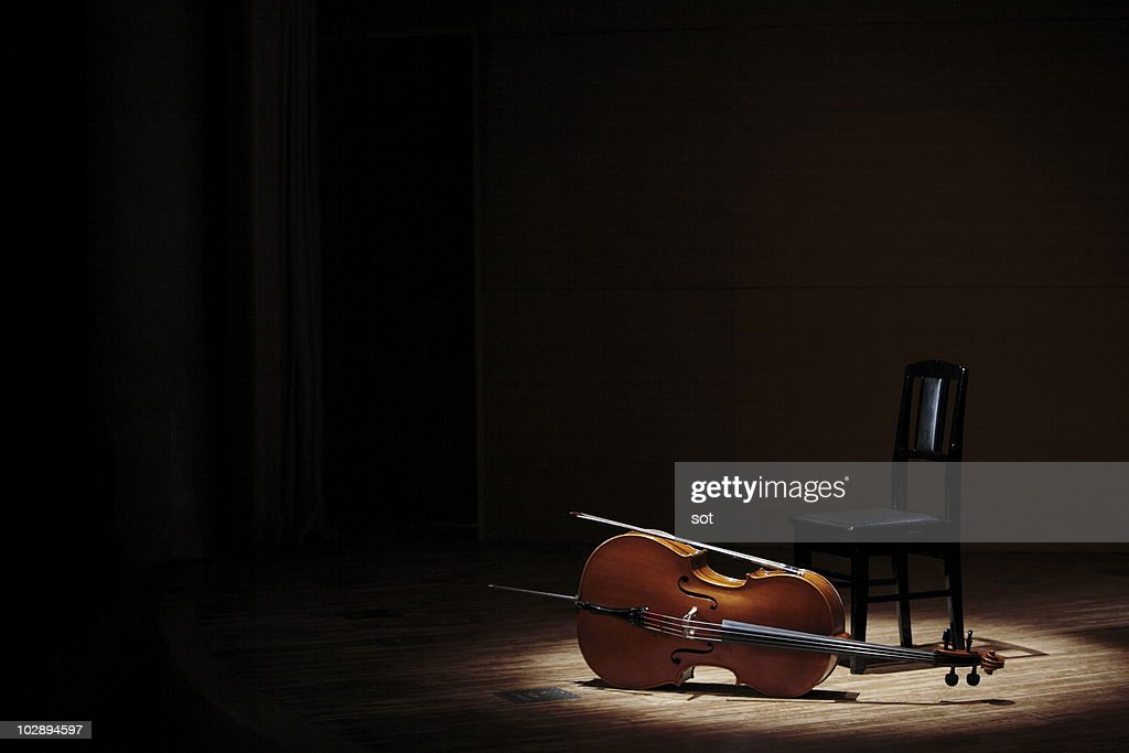 Cello and chair on stage : Stock Photo