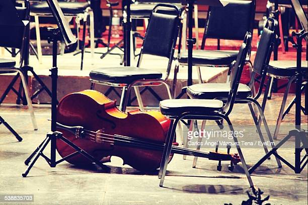 Cello And Empty Chairs In Concert Hall