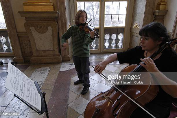 Cello player Barbara Luebke a chamber musician for the past 40 years trains her prodigy son Benjamin to play the violin every day one and a half...