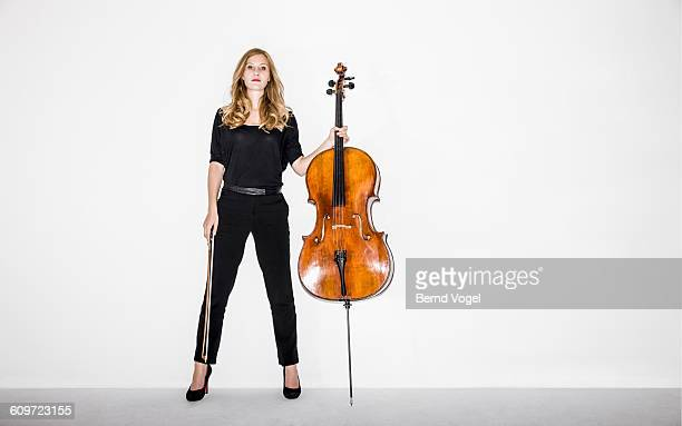 cello player - cello stock pictures, royalty-free photos & images