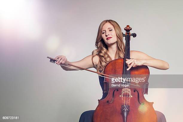 cello player - cellist stock pictures, royalty-free photos & images