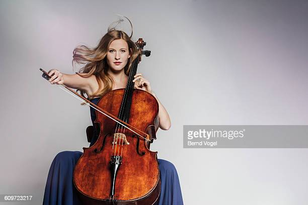 cello player - musician stock pictures, royalty-free photos & images