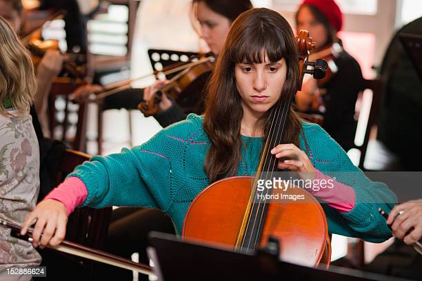 cello player practicing with group - rehearsal stock pictures, royalty-free photos & images