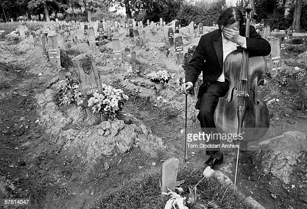 Celloist Vedran Smalovic breaks down in tears after playing a requiem to a dead friend in Hero's Cemetery where Bosnian fighters were buried during...