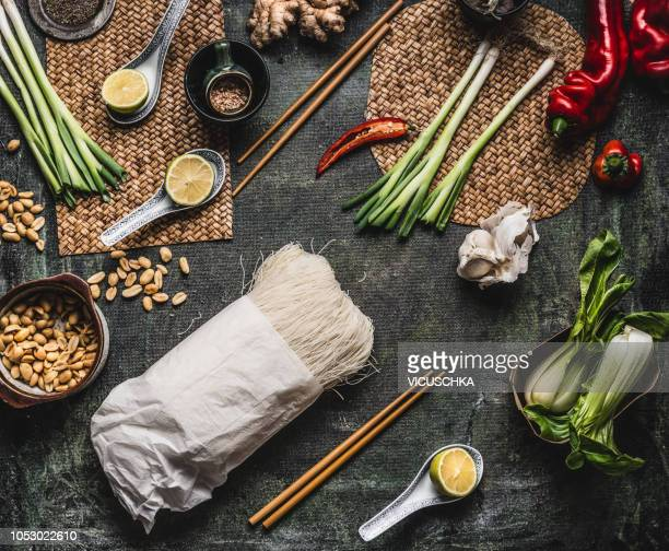 Cellophane or glass noodles with vegetarian asian cooking ingredients on kitchen tables