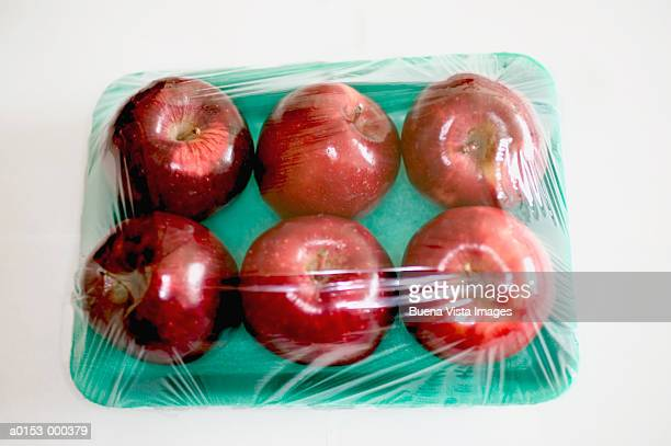 cellophane wrapped apples - packaging stock pictures, royalty-free photos & images