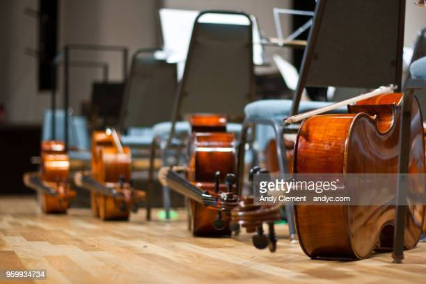 cellos - andy clement stock photos and pictures