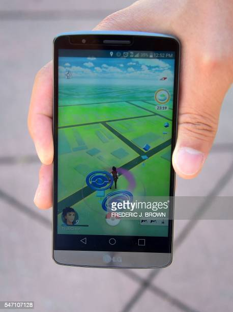 A cellphone screen shows the game Pokemon Go on July 13 2016 in San Gabriel California near the San Gabriel Mission one of a number of landmarks...