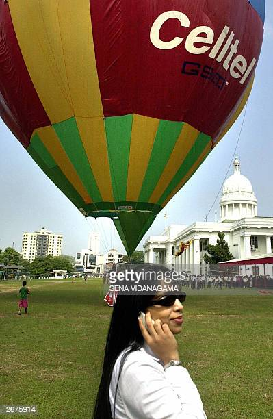Cellular operator Celltel's employee Udeni Rambukwella makes a mobile phone call outside Colombo's municipal Town Hall 29 October 2003 during the...