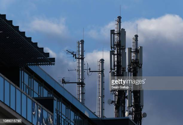 A cellular phone tower stands on top of an office building on January 02 2019 in Berlin Germany Germany's mobile phone service providers are taking...