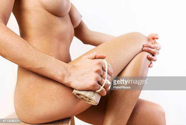 Cellulite massage with natural sponge. Weight loss