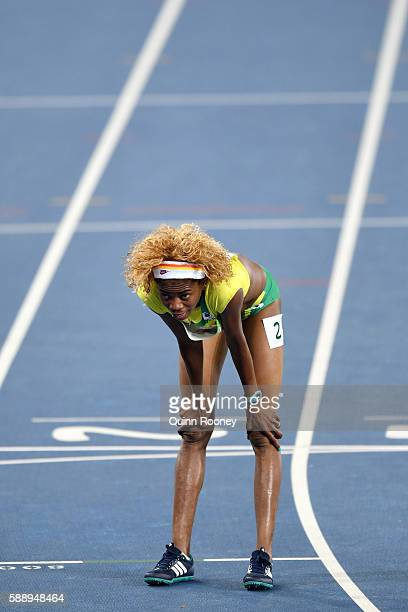Celma Bonfim da Graca of Sao Tome and Principe reacts after the Women's 1500m Round 1 Heat 1 on Day 7 of the Rio 2016 Olympic Games at the Olympic...
