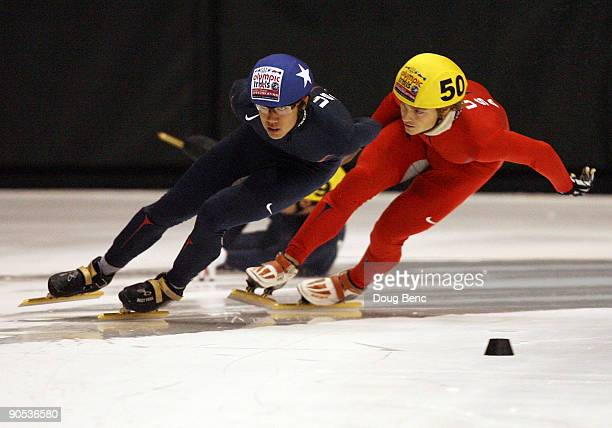 R Celski and Joey Lindsey skate around turn two as Eduardo Alvarez falls down during the Men's 1500 Meter Semifinal at the US Short Track...