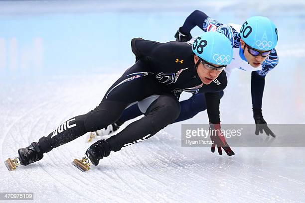 R Celski of the United States and Victor An of Russia compete in the Short Track Men's 5000m Relay Final A on day fourteen of the 2014 Sochi Winter...