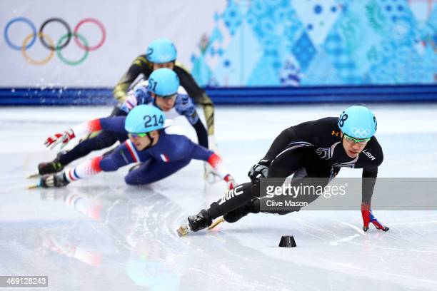 R Celski of the United States leads the pack as Maxime Chataignier of France Semen Elistratov of Russia and Ryosuke Sakazume of Japan collide compete...