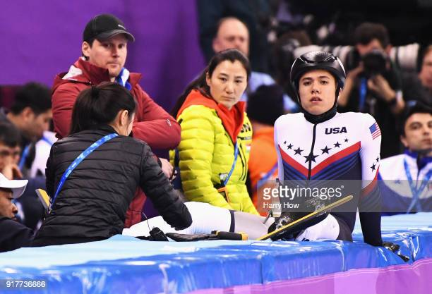 R Celski of the United States repairs his skates after a crash during the Men's 1000m Short Track Speed Skating qualifying on day four of the...