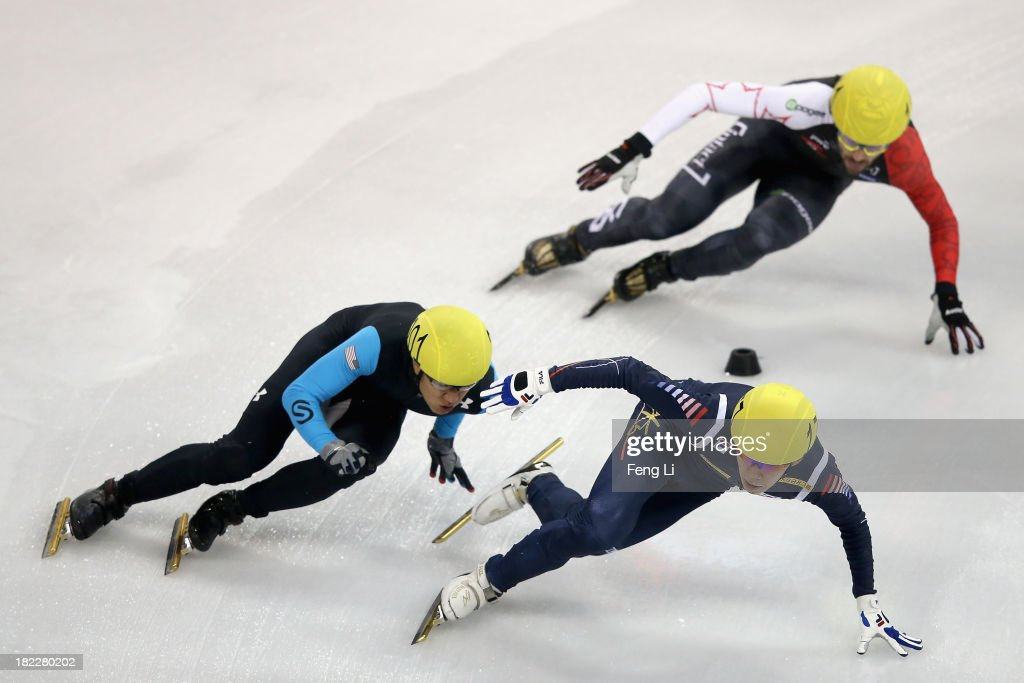 J.R. Celski of United States (Left), Lee Ho-Suk of Korea (Right) and Charles Hamelin of Canada (Top) compete in the Men's 5000m Relay Final during day four of the Samsung ISU World Cup Short Track at the Oriental Sports Center on September 29, 2013 in Shanghai, China.