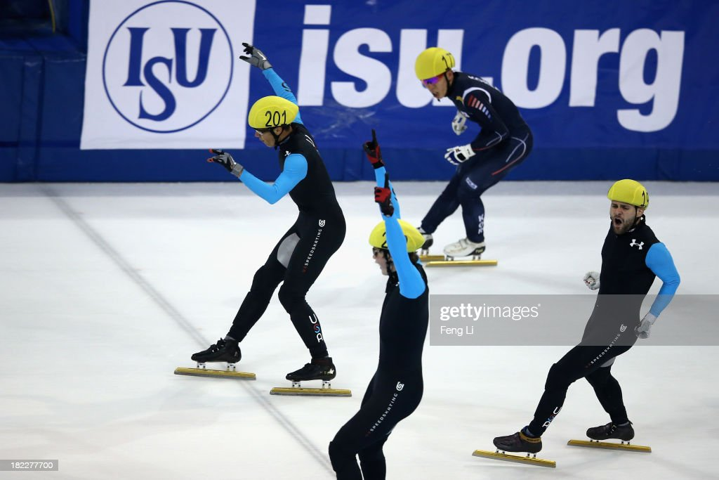 J.R. Celski of United States team (Left) celebrates winning the Men's 5000m Relay Final during day four of the Samsung ISU World Cup Short Track at the Oriental Sports Center on September 29, 2013 in Shanghai, China.