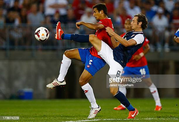 Celso Borges of Costa Rica fights for the ball against Mix Diskerud of the United States in the first half during the CONCACAF Gold Cup match at...